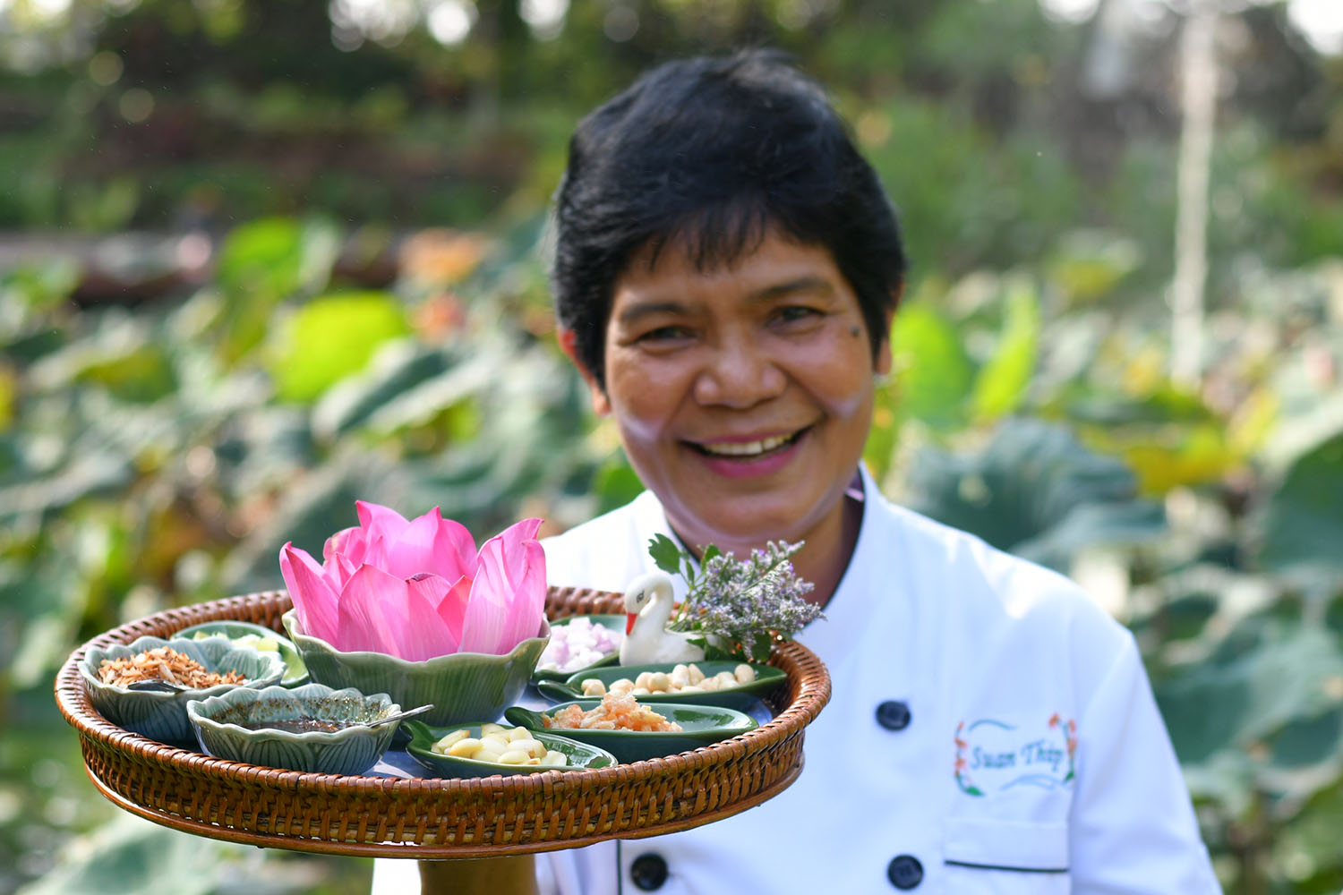 Banyen Ruangsantheia holds a tray of Lotus Wraps in November 2018, soon after she won her first Michelin star.